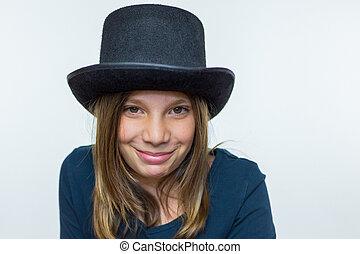 Girl in black wearing top hat