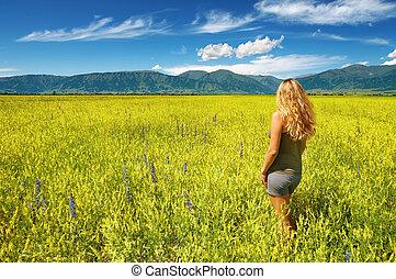 Girl in blooming field