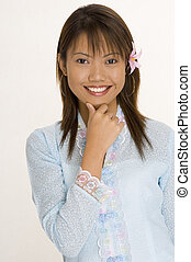 Girl In Blue 1 - A pretty young asian girl in a light blue ...