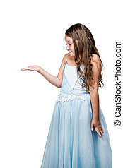 Girl in blue dress looking at his hand