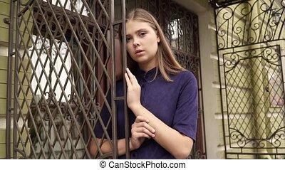 Girl in blue dress posing on camera