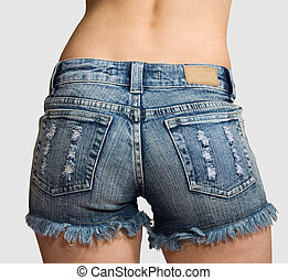 Girl in blue jeans short shorts isolated - Girl in blue...