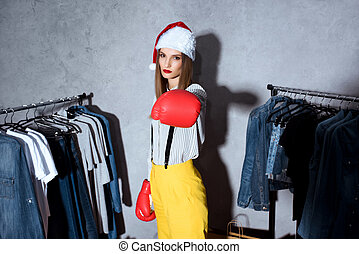 girl in boxing gloves in boutique