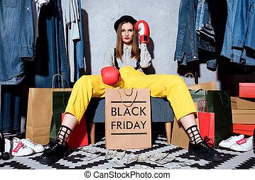 girl in boxing gloves on black friday