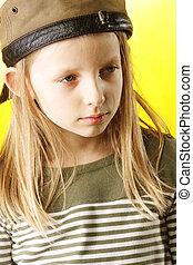 Girl in brown cap