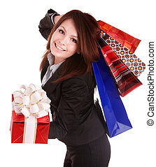 Girl in business suit with group gift box and bag.