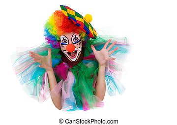 Girl in cap and clown costume with a bouquet of flowers puts out the tongue looks up isolated on white background.