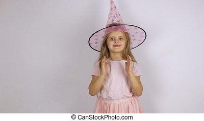 Girl in carnival hat jumps, dances - Girl in carnival hat...