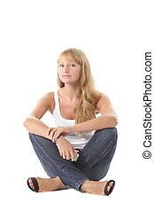 Girl in casual sitting on white