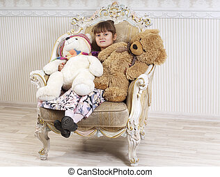 Girl in chair with a bear