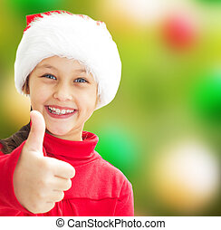 girl in Christmas clothes showing thumb on a colorful background