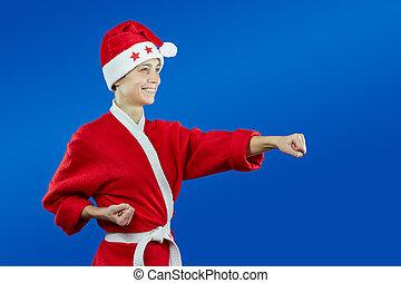 girl in cloth as Santa Claus beats