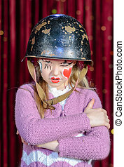 Girl in Clown Make Up and Helmet with Arms Crossed