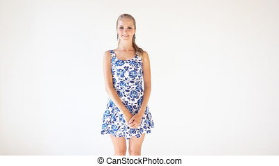 girl in colored dress posing shows the direction of