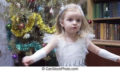 Girl in costume at Christmas tree