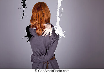 Girl in dress in studo with abstract black and white milk.