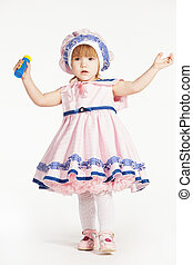 Little girl in a pink dress lake a sailor