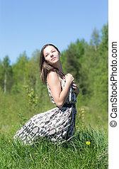girl in dress on grass
