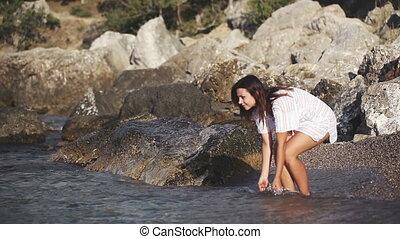 Girl in dress on seashore