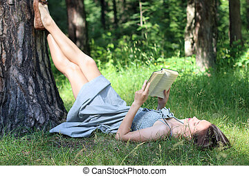 girl in dress reading book