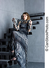 girl in dress sitting on stairs