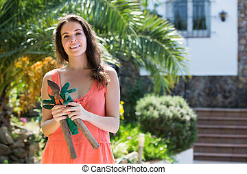 Girl in dress with pruner