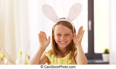 girl in easter bunny ears playing peek a boo game - easter,...