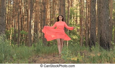Girl in evening dress on a hill in the forest - Girl in...