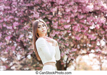 Girl in Fantasy Mystical and Magical Spring Garden. Fashion Model. Beauty Portrait