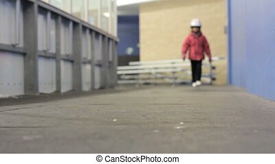 Girl In Figure Skates Walks to Ice
