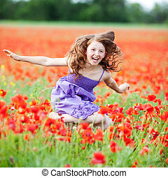 Girl in flower field - Happy little girl playing in fresh...