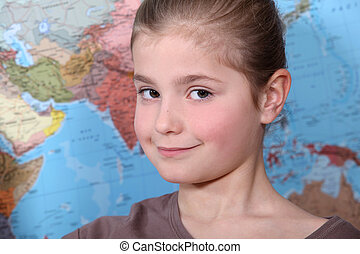 Girl in front of a world map