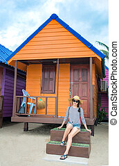 Girl in front of beach house