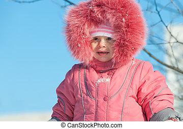 Girl in front of winter sky