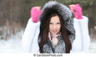 Girl in furry hood - Girl in a furry hood breathing out into...