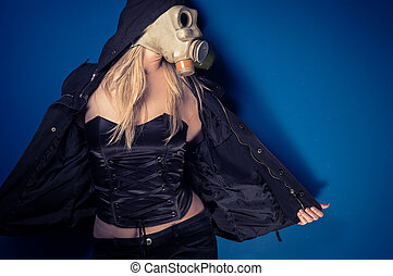 Girl in gasmask against blue background