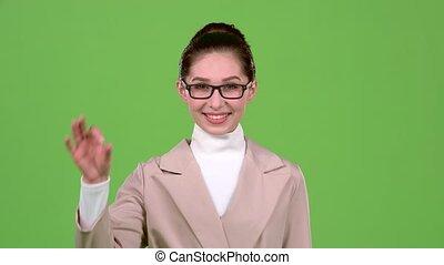 Girl in glasses shows ok. Green screen - Girl in glasses...