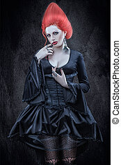 Girl with red hair in the Gothic style.