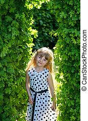 girl in green garden