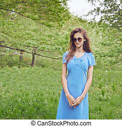 Girl in green park
