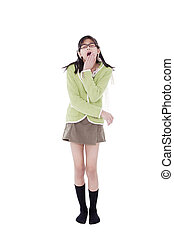 Girl in green sweater and glasses looking up, yawning