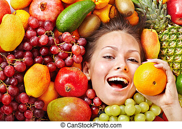 Girl in group of fruit.