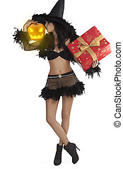 girl in halloween dress standing with gift box jack-o'-lantern