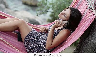 Girl in hammock smartphone