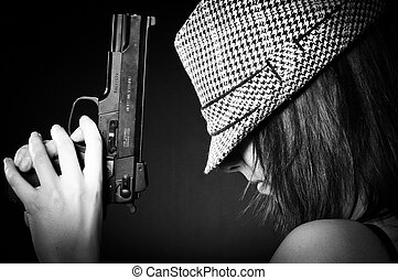 Girl in hat with a big pistol