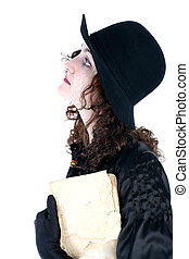 girl in hat with old book isolated on white