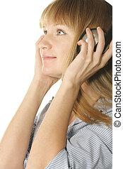 Girl in headphones looking to side