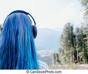 Girl in headphones outdoor.