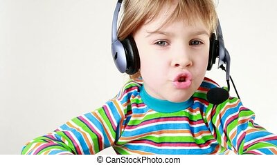 Girl in headset shakes her head and sings - Girl in headset...