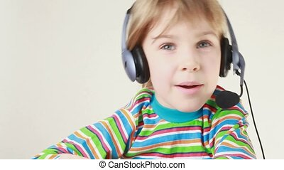 Girl in headset swings from side to side and sings